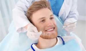 The dentist will start to clean the patient's teeth.