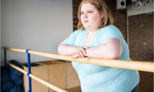 The woman suffers from obesity and eating disorders.