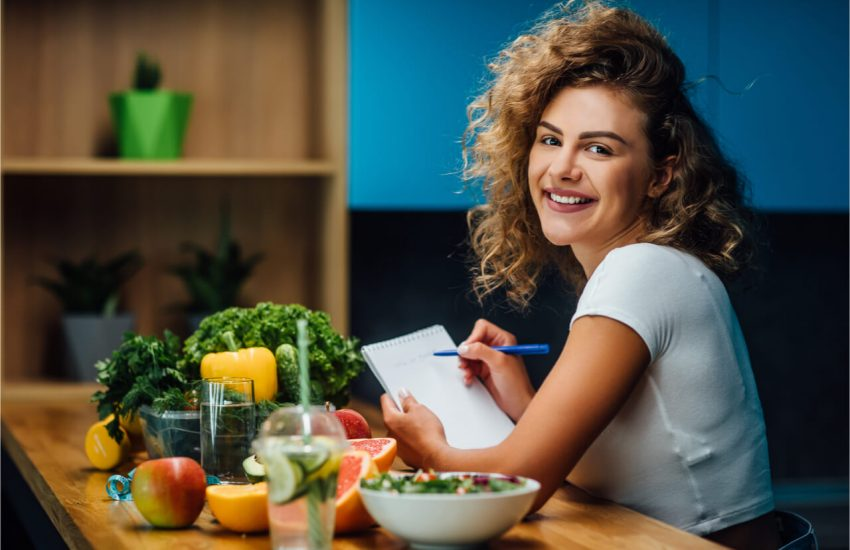 The woman is listing the preparation she needs for a healthy diet.